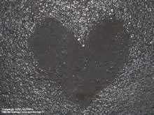 puddle forming a heart