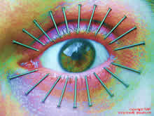 eye lashes with nails close to the pupil