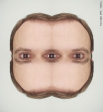mirrored face with 3 eyes watching you